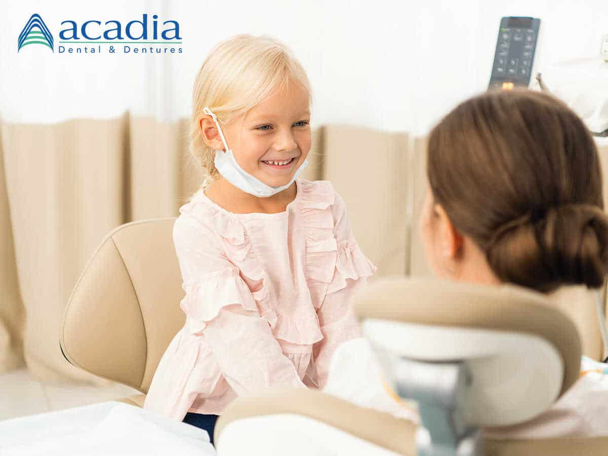 A kid being treated by a professional Frederick dentist